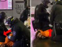 lors d'une arrestation à Seattle un policier enleve le genou de son collège du cou du suspect
