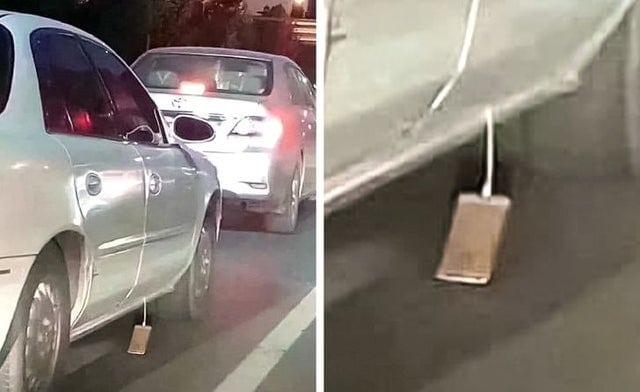 Un automobiliste qui laisse traîner sur la route son iPhone qui charge.