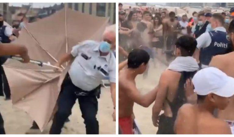 Vidéo : Bagarre générale sur une plage en Belgique, des jeunes attaquent des policiers avec des parasols