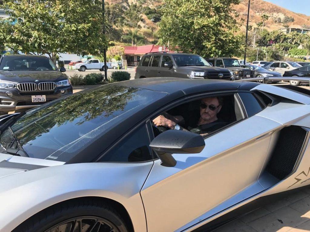 Le Taulier au volant d'une Lamborghini Aventador