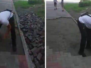 Ouvrier enlevant des pavés